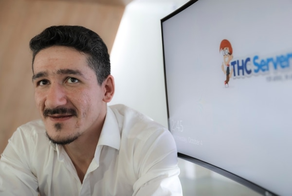 Catalin Florica, who launched THCServers.com in 2013, poses for a portrait during an interview at the company's headquarters, outside Craiova, southern Romania, Wednesday, Oct. 4, 2017. The company based in a remote part of the Eastern European country was used to register the website DCLeaks, which U.S. intelligence has accused of being a front for Russian spies. (AP Photo/Vadim Ghirda)