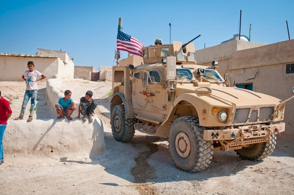 Children gather around a U.S. tactical vehicle during a patrol along the demarcation line outside Manbij, Syria, July 14, 2018. (Staff Sgt. Timothy R. Koster/Army)