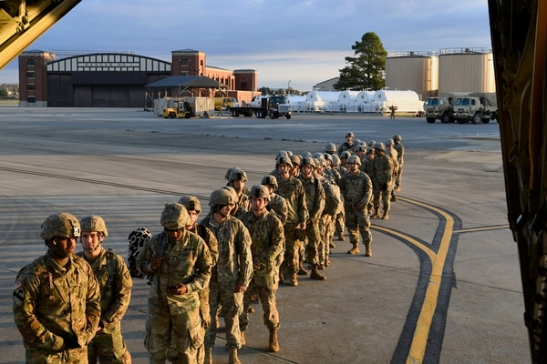 Soldiers from the 541st Sapper Company prepare to board an Air Force C-130J Super Hercules on Oct. 30, 2018, at Ft. Knox, Ky., in support of Operation Faithful Patriot, the active-duty mission along the southern U.S. border. (Airman First Class Daniel A. Hernandez/Air Force)