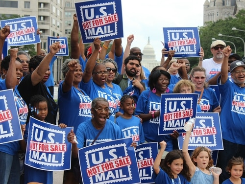 Members of a variety of federal employee unions rallied outside congressional offices across the country and in Washington, D.C., to protest potential privatization of the U.S. Postal Service. (Jessie Bur/Staff)