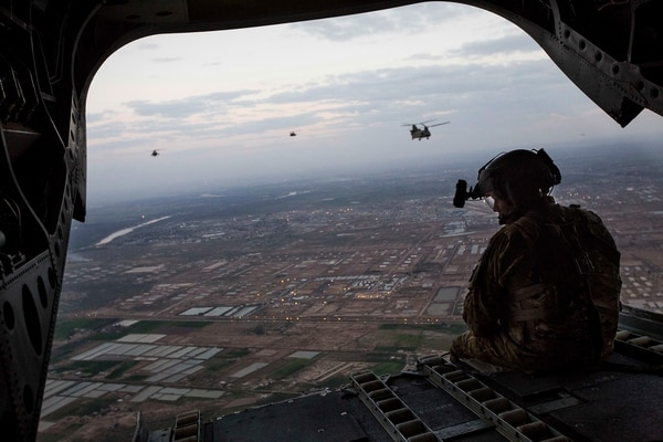U.S. Army AH-64D Apache Longbow helicopters escort two CH-47 Chinook helicopters carrying U.S. Marines with Task Force Spartan, 26th Marine Expeditionary Unit (MEU), over Taji, Iraq, as they head to Kara Soar for their mission in support of Operation Inherent Resolve on March 17, 2016. Operation Inherent Resolve is an international U.S. led coalition military operation created as part of a comprehensive strategy to degrade and defeat the Islamic State of Iraq and the Levant. (U.S. Marine Corps photo by Cpl. Andre Dakis/Released)