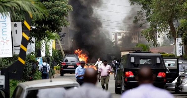 Fire and smoke rise from an explosion in Nairobi, Kenya, Jan. 15. An upscale hotel complex in Kenya's capital came under attack on Tuesday, the latest high-toll assault inside that county in retaliation for Kenya sending troops to Somalia to fight al-Shabab. (Khalil Senosi/AP)