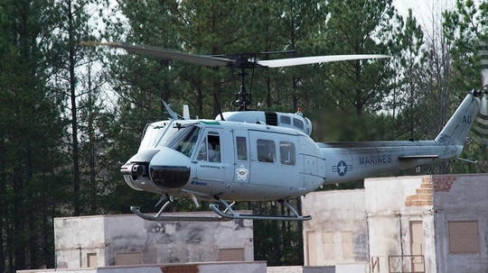 A Marine UH-1Y Venom equipped with the Autonomous Aerial Cargo/Utility System lands during final testing at Marine Corps Base Quantico. (John F. Williams)