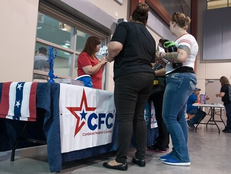 Federal employees receive information while participating at the Combined Federal Campaign kickoff for El Paso and Fort Bliss, Texas, in 2016. (Sgt. Maricris McLane/Army)