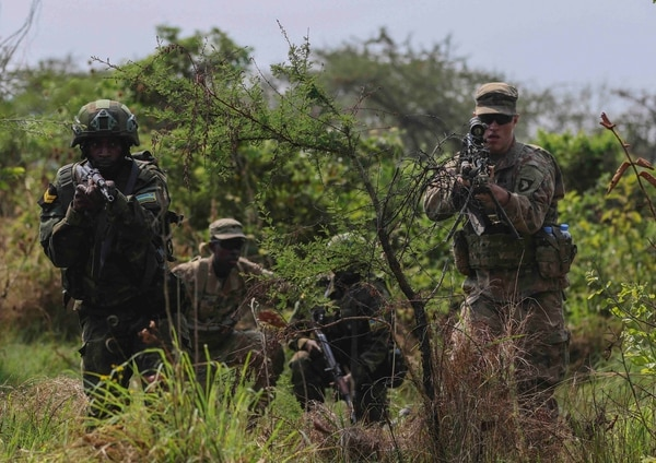 U.S. soldiers with the 2nd Brigade Combat Team, 101st Airborne Division run through squad battle drills with a member of the Rwanda Defence Force during Exercise Shared Accord in Gabiro, Rwanda on Aug. 20, 2019. (Sgt. Heather Doppke/Army)