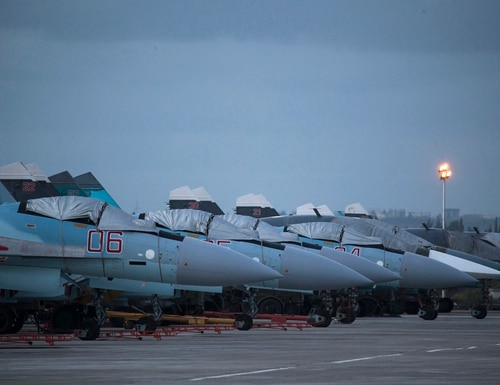 FILE - In this Friday, March 4, 2016 file photo, Russian fighter jets and bombers are parked at Hemeimeem air base in Syria. Russian warplanes have mostly stayed on the ground since the Russian- and U.S.-brokered cease-fire has begun last weekend. Russia's defense ministry said Tuesday, March 15, 2016, that the first group of warplanes stationed at the Russian air base in Syria has left for home following a pullout order from President Vladimir Putin. (AP Photo/Pavel Golovkin, File)