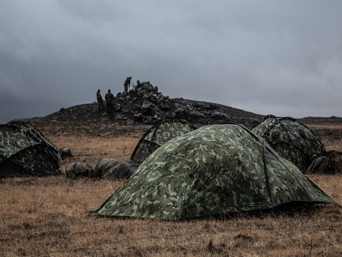 U.S. Marines use tents for shelter from the Icelandic wind and rain as they prepare for NATO's Trident Juncture exercise. (DoD)