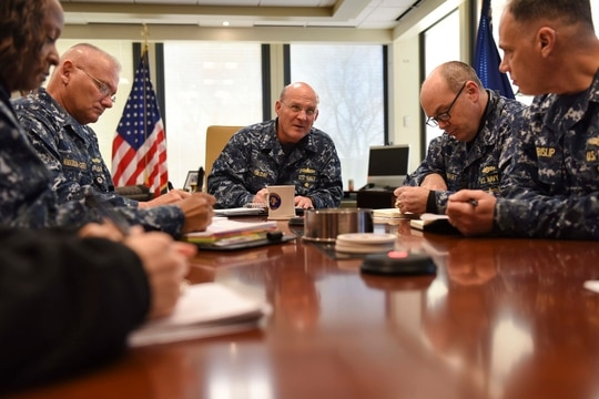 FORT GEORGE G. MEADE, Md. (December 12, 2017) – Vice Adm. Mike Gilday, commander U.S. Fleet Cyber Command/U.S. 10th Fleet (FCC/C10F), meets with meets with Command Master Chief Dee Allen and assistant chiefs of staff during a regularly scheduled morning brief. U.S. Fleet Cyber Command serves as the Navy component command to U.S. Strategic Command and U.S. Cyber Command. U.S. 10th Fleet is the operational arm of Fleet Cyber Command and executes its mission through a task force structure. (Mass Communication Specialist 1st Class Samuel Souvannason/Navy)