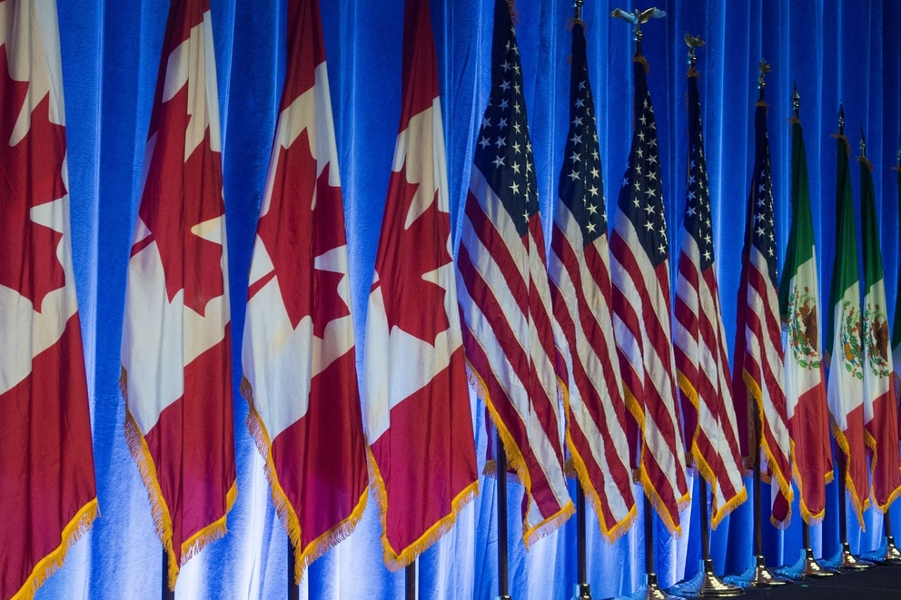 The flags of Canada, the United States and Mexico line the stage before the start of the negotiations for the modernization of NAFTA on Aug. 16, 2016, in Washington, D.C. (Paul J. Richards/AFP via Getty Images)