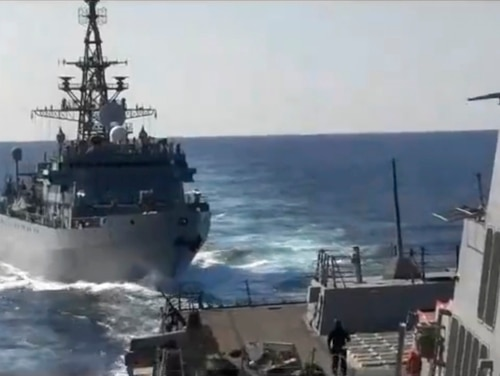 This photo provided by the U.S. 5th Fleet, shows a Russian Navy ship approaching an American warship in the North Arabian Sea on Thursday. (U.S. 5th Fleet via AP)
