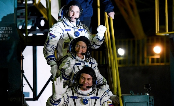 U.S. astronauts Nick Hague, above, Christina Hammock Koch and Russian cosmonaut Alexey Ovchinin, crew members of the mission to the International Space Station, wave as they board prior to the launch of their Soyuz MS-12 space ship at the Russian leased Baikonur cosmodrome in Kazakhstan, March 14. (Kyrill Kudryavtsev/AP)
