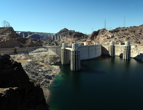 View of the Hoover Dam and the newly completed by-pass bridge (background) which spans the Colorado River and was dedicated on October 14, 2010, at its site on the border of Arizona and Nevada. (MARK RALSTON/AFP/Getty Images)