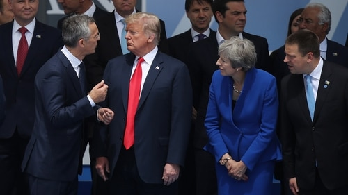 NATO Secretary General Jens Stoltenberg, left, U.S. President Donald Trump and British Prime Minister Theresa May attend the opening ceremony of the 2018 NATO Summit on July 11, 2018, in Brussels, Belgium. (Sean Gallup/Getty Images)