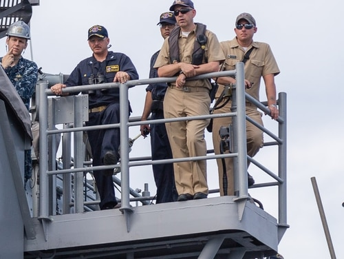 Capt. Aycock looks on as the Shiloh is brought into dry dock for scheduled maintenance. (Lt. j.g. William McGough/Navy)