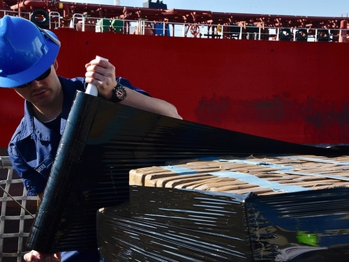 A Coast Guard Cutter Forward (WMEC-911) crewmember wraps bales of interdicted cocaine to be offloaded at Port Everglades, Fla., Feb. 5, 2019. The Forward crew offloaded approximately 34,780 pounds of cocaine at Port Everglades worth an estimated $466 million wholesale seized in international waters in the eastern Pacific Ocean. (Petty Officer 3rd Class Brandon Murray/Coast Guard)