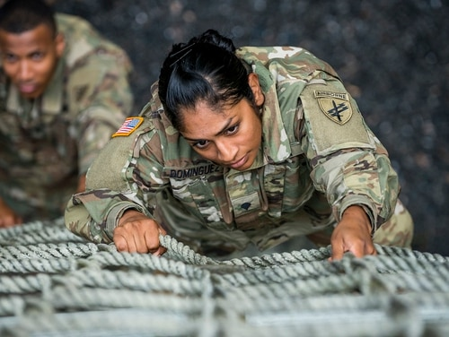 Spc. Mirna Averrus, with the 426th Civil Affairs Battalion, navigates an obstacle course at Joint Base McGuire-Dix-Lakehurst, N.J., July 25, 2017. (Master Sgt. Michel Sauret/Army)