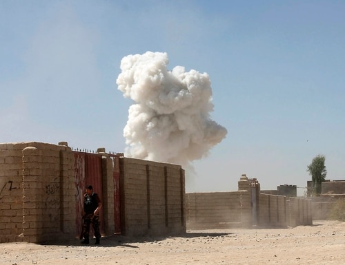 Smoke rises after a suicide attack in Lashkar Gah the capital of southern Helmand province of Afghanistan, Monday, Oct. 10, 2016. A suicide car bombing on Monday killed many people, including 10 Afghan police officers, as the Taliban launched a large-scale attack on the capital in southern Helmand province, the heartland of the insurgency. (AP Photo/Abdul Khaiq)