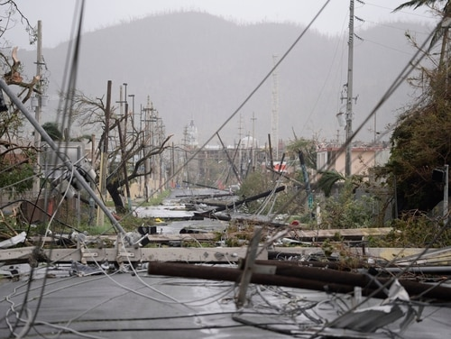 Electricity poles and lines lay toppled on the road after Hurricane Maria hit Humacao, Puerto Rico, on Sept. 20. (Carlos Giusti/AP)