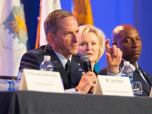 Air Force Chief of Staff Gen. David Goldfein, left, speaks during a town hall session at the Air Force Association's Air, Space and Cyber Conference on Sept. 18. Also on the panel were his wife Dawn and Chief Master Sgt. of the Air Force Kaleth Wright. (Alan Lessig/Staff)