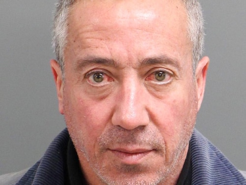 Christian Desgroux, 57, is accused of pretending to be a U.S. Army general when he landed a chartered helicopter at a technology company in North Carolina in November. (Wake City-County Bureau of Identification via AP)