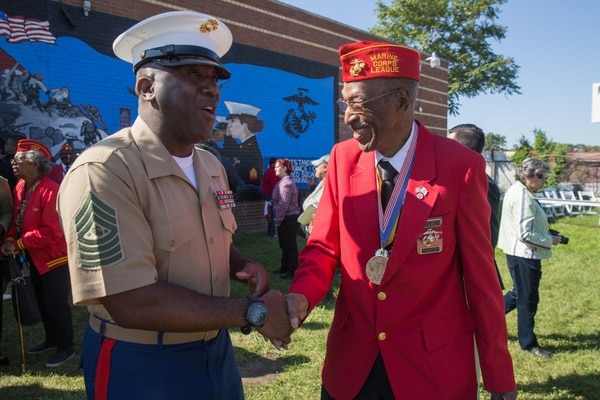 Sergeant Major of the Marine Corps Ronald L. Green shakes hands with George G. Cranberry Jr., a Montford Point Marine, during Marine Week Detroit, Sept. 9, 2017. (Lance Cpl. Danny Gonzalez/Marine Corps)