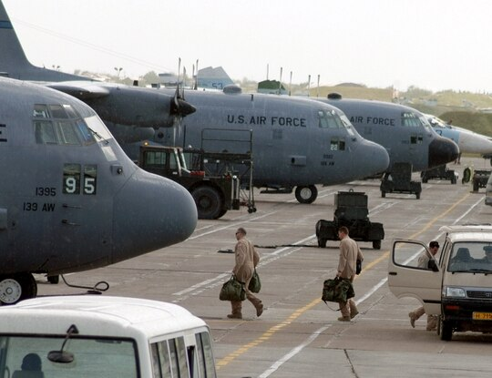 C-130 Hercules aircrew members board their aircraft for an Operation Enduring Freedom mission at Karshi-Khanabad Air Base, Uzbekistan, on April 19, 2005. Hundreds of veterans who served on the base have been diagnosed with cancer, according to members of Congress and veterans advocates. (Air Force)