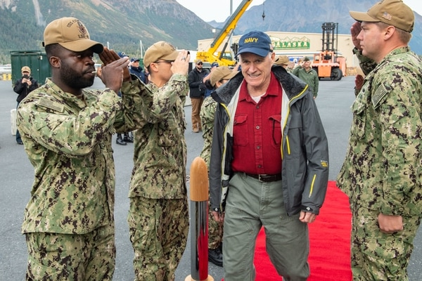 Sideboys salute as Secretary of the Navy Richard V. Spencer approaches the amphibious dock landing ship Comstock on Sept. 17 during Arctic Expeditionary Capabilities Exercise 2019. The drills test expeditionary logistical capabilities in the Arctic region and prepare joint forces to respond to crises. (Mass Communication Specialist 2nd Class Nicholas Burgains/Navy)