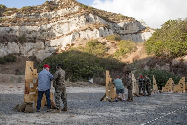 Marine Vietnam veterans shoot the M4 carbine at at Marine Corps Base Camp Pendleton, California, after their Nov. 21 Purple Heart ceremony. (Cpl. Ana S. Madrigal/Marine Corps)