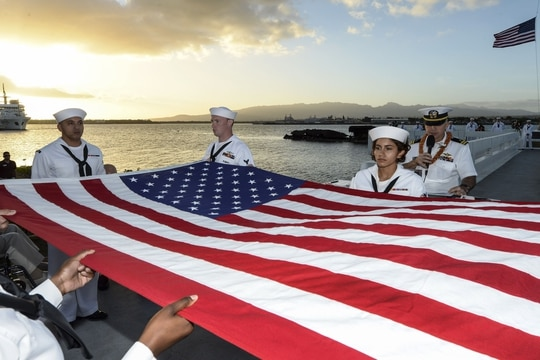 Sailors fold an American flag during a double interment as part of a ceremony at Joint Base Pearl Harbor-Hickam, Hawaii, Dec. 6, 2017, to mark the attacks on Pearl Harbor and Oahu. Navy photo by Randi Brown