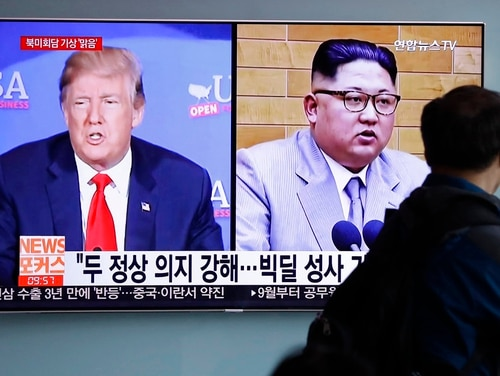 In this May 11, 2018, file photo, a man watches a TV screen showing file footage of U.S. President Donald Trump, left, and North Korean leader Kim Jong Un during a news program at the Seoul Railway Station in Seoul, South Korea. (Lee Jin-man/AP)
