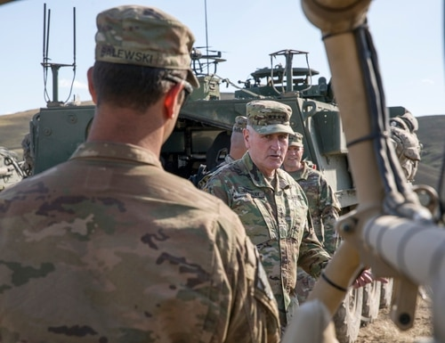 U.S. Army Gen. John Murray, head of Army Futures Command, speaks about the advancement of unmanned vehicles during a brief on equipment being tested for the Joint Warfighting Assessment 19 on May 7, 2019. (Spc. Audrey Ward/U.S. Army)
