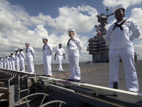 Sailors assigned to aircraft carrier Gerald R. Ford man the rails in honor of the 79th anniversary of the Battle of Midway as they depart Naval Station Norfolk , June 7, 2021. (Mass Communication Specialist 1st Class Julie R. Matyascik/Navy)