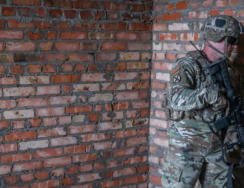 Sgt. Christopher Phelps awaits maneuver commands during an urban operations demonstration as part of Rapid Trident 2019 at Combat Training Center-Yavoriv. (Army)