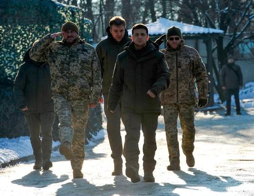 Ukrainian President Volodymyr Zelenskiy, second from right, meets with servicemen while visiting the Donetsk region of Ukraine on Dec. 6, 2019. (Evgenya Maksymova/AFP via Getty Images)