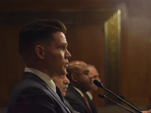 Ben Wells, Air Force veteran and a volunteer for Vet2Vet talks at a Senate hearing Wednesday (Niko Boskovic/Medill News Service)