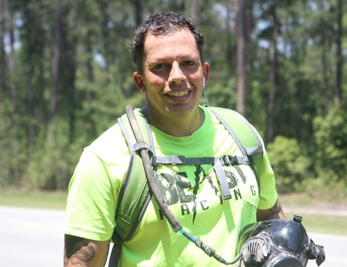Sgt.1st Class Augusto Piñeiro, a combat engineer and platoon sergeant with Company B, 9th Brigade Engineer Battalion, 2nd Infantry Brigade Combat Team, 3rd Infantry Division, takes a break after completing a 25-mile run wearing a gas mask at Fort Stewart, Ga., May 9, 2016. The training is in preparation for attempt to break the record for running the longest distance while wearing a gas mask. (U.S. Army photo by Spc. Nicholas Holmes/ Released)