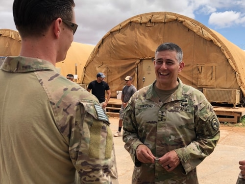 Gen. Stephen Townsend, commander of U.S. Africa Command, presents a coin to a service member who is helping to train Somali forces in in Somalia. Townsend recognized the contributions made by U.S. units involved in helping the Somalis build defense capabilities. (AFRICOM)