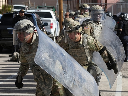 Soldiers from the 65th MP (Military Police) Company Airborne, 503rd MP Battalion Airborne, 16th MP Brigade, perform a simulation crowd control exercise with U.S. Customs and Border Protection agents at the DeConcini Port of Entry, Nogales, Ariz., on Dec. 4, 2018. (Sgt. Kyle Larsen/Army)