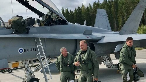 U.S. Air Force Chief of Staff Gen. Dave Goldfein discusses a just-completed training flight July 15, 2019, with Finnish Air Chief Maj. Gen. Pasi Jokinen. (Charles Pope/U.S. Air Force)