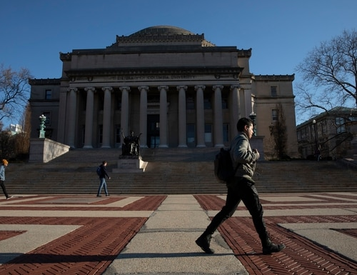 A man walks past Low Library on the Columbia University campus on March 9, 2020, in New York. (Mark Lennihan/AP)