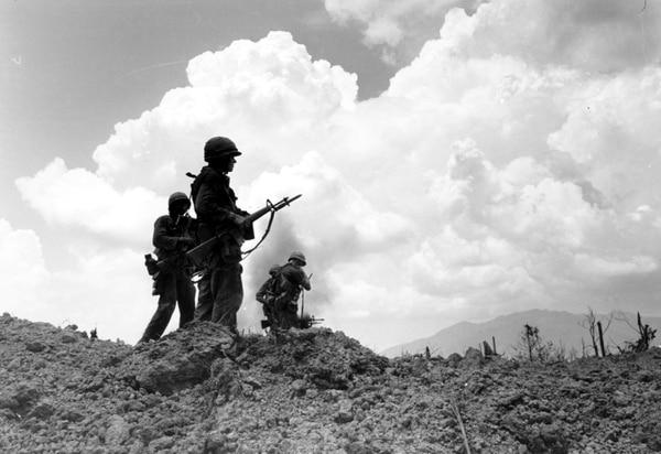 U.S. Marines are silhouetted as they stand on Hill 881 North after a fierce nine-day battle near Khe Sanh, Vietnam on May 3, 1967, during the Vietnam War. (Associated Press)