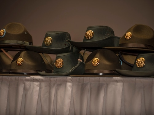Hats are stacked up to be presented to graduating drill instructors at Fort Jackson, South Carolina. (Sgt. 1st Class Brian Hamilton/Army)