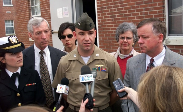 JAC09:ITALY-CABLECAR-MARINE;JACKSONVILLE, NC.2APRIL99-Marine Capt. Joseph Schweitzer (center) speaks at a press conference at Camp LeJeune, NC on Friday, April 2, 1999 after a military jury rendered a verdict of dismisal from the Marine Corp for his guilty plea of obstruction of justice. With him are his attorneys and family members, Navy Lt. Kathryn Clune (far left) his father Joe Schweitzer (2nd left) his sister Courtney Schweitzer (center back) his mother Pat Schweitzer (back right) and his civilian attorney Dave Beck (right front).rbd\Photo by Randy Davey REUTERS