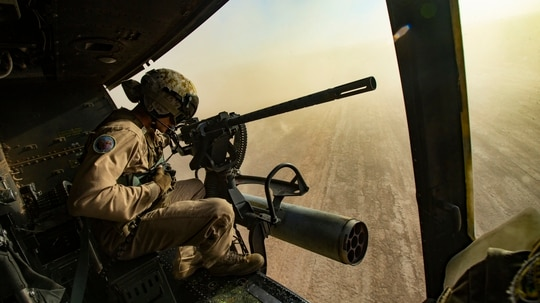 Marine Cpl. Brock Gilbert observes the landing zone in support of an offensive air support exercise during Weapons and Tactics Instructor (WTI) course 1-20 at Chocolate Mountain Aerial Gunnery Range, California, Oct. 1, 2019. (Cpl. Claudia Nix/Marine Corps)