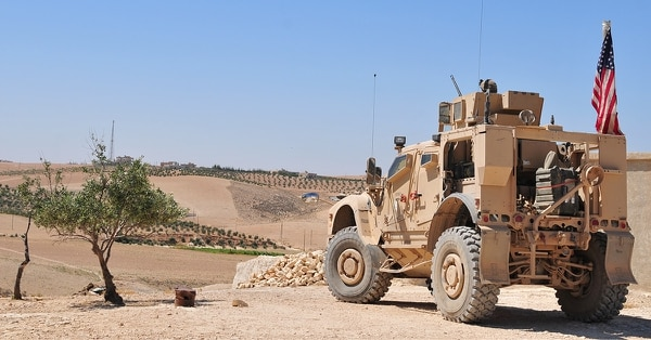 U.S. personnel provide security from a tactical vehicle in a local village during an independent patrol outside Manbij, Syria, Aug. 11, 2018. These independent, coordinated patrols are conducted with Turkish military forces who stay on the opposite side of the demarcation line. (Sgt. Nicole Paese/Army)