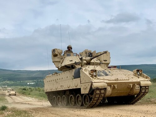 Army Bradley Fighting Vehicles from 1st Battalion, 16th Infantry Regiment, travel to battle positions during STRIKE BACK 19 at the Bulgarian Land Forces' Novo Selo Training Area. In 2020, soldiers at Fort Carson, Colorado, will use modified Bradleys while remote controlling robotic vehicles in a platoon-sized mechanized assault. (Capt. Erica Mitchell/Army)