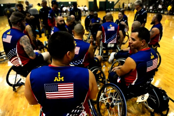 Team U.S. wheelchair basketball members huddle after a game at the Orlando Invictus Games 2016, ESPN Wide World of Sports Complex at Walt Disney World Resort Orlando, Fla. May 7, 2016. The Invictus Games are composed of 15 nations, over 500 military competitors, competing in 10 sporting events May 8-12, 2016. (U.S. Air Force photo by Staff Sgt. Carlin Leslie/Released)
