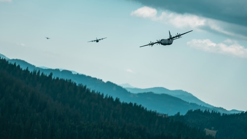 Two U.S. C-130J Super Hercules aircraft and a Bulgarian C-27J Spartan aircraft fly low-level formation flights in Bulgaria, Aug. 17, 2020. 5G deployment could pose an additional risk for low-level flight like this. (Tech. Sgt. Devin Nothstine/U.S. Air Force)
