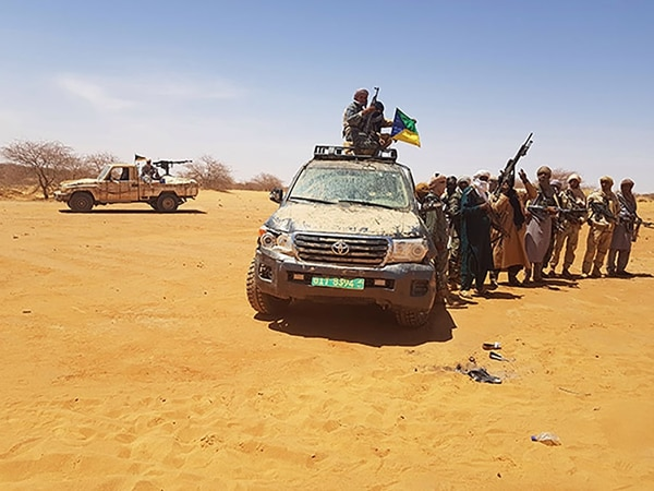 This March 2018 image in Menaka, Mali, shows local militants with an off-road vehicle recovered during an operation and said to have belonged to four American soldiers killed during an ambush in the Tongo Tongo area in West Niger on Oct. 4, 2017. (AFP via Getty Images)