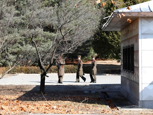 In this Nov. 27, 2017, file photo, three North Korean soldiers look at the South side at the spot where a North Korean soldier crossed the border on Nov. 13, at the Panmunjom in the Demilitarized Zone, South Korea. (Lee Jin-man/AP)